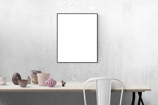 Biały plakat na szarej ścianie